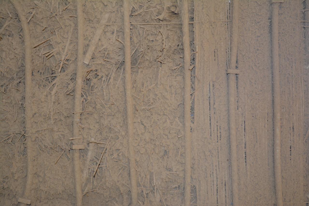 Detail Wandheizung auf Strohballen
